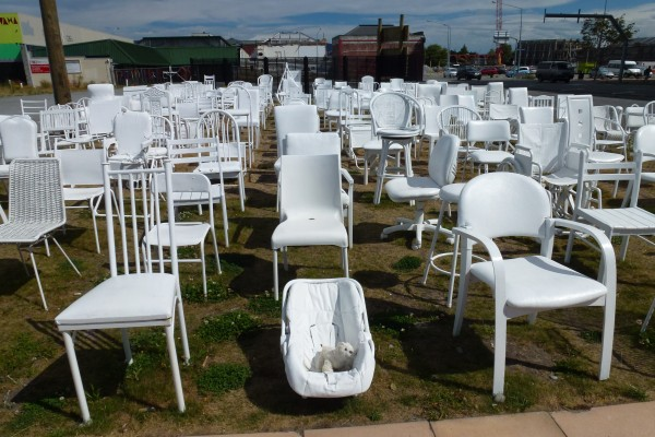 An artist made this installation: 185 empty chairs for the 185 victims of the earthquake